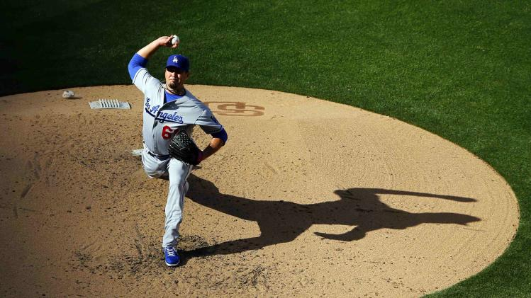 Los Angeles Dodgers starting pitcher Josh Beckett pitches against the San Diego Padres in the fourth inning of their MLB National League baseball game in San Diego