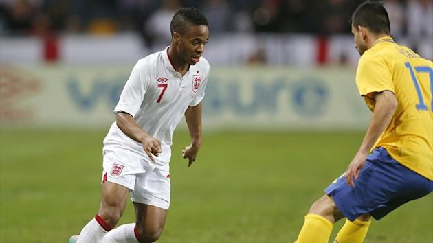 England's Raheem Sterling (L) is challenged by Sweden's Behrang Safari during their international friendly soccer match at the Friends Arena in Stockhom November 14, 2012