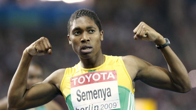 """FILE - In this Aug. 19, 2009 file photo, South Africa's Caster Semenya celebrates after winning the gold medal in the final of the Women's 800m at the World Athletics Championships in Berlin. While her rivals battled for Commonwealth Games gold, and soaked up the acclaim in New Delhi, Caster Semenya was left fretting over her finances and wondering if she can afford to keep running. A gender test controversy and the ensuing 11-month layoff from competition has robbed the 800-meter world champion of more than just time on the track. Despite being cleared to run by the IAAF, Semenya's manager, Tshepo Seema, says Thursday Oct 28 2010 that she can't find a sponsor """"because of the negative publicity.""""  (AP Photo/Anja Niedringhaus, File)"""