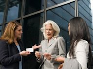 Business Women Exchanging Business Cards
