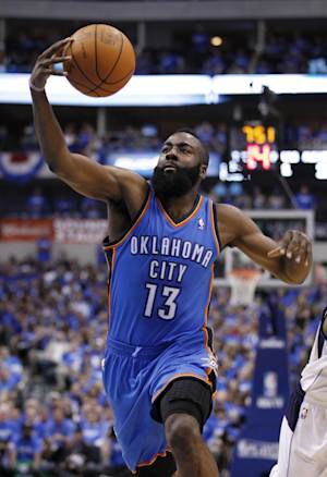 In this May 3, 2012 photo, Oklahoma City Thunder's James Harden (13) grabs a loose ball against the Dallas Mavericks during Game 3 in the first round of the NBA basketball playoffs in Dallas. The Thunder have traded Sixth Man of the Year Harden to the Houston Rockets, breaking up the young core of the Western Conference champions. The Thunder acquired guards Kevin Martin and Jeremy Lamb, two first-round picks and a second-round pick in the surprising deal that was completed Saturday night, Oct. 27, 2012. Oklahoma City also sent center Cole Aldrich, and forwards Daequan Cook and Lazar Hayward to Houston.  (AP Photo/Tony Gutierrez)