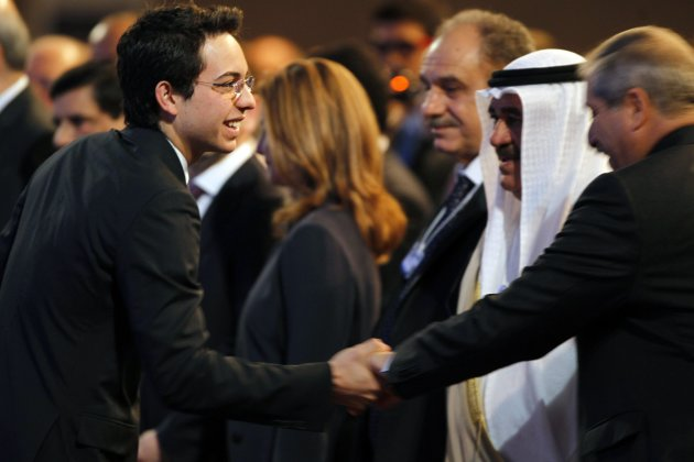 Jordan's Crown Prince Hussein greets Foreign Minister Nasser Judeh upon his arrival for the opening ceremony of the World Economic Forum on the Middle East and North Africa at the Dead Sea