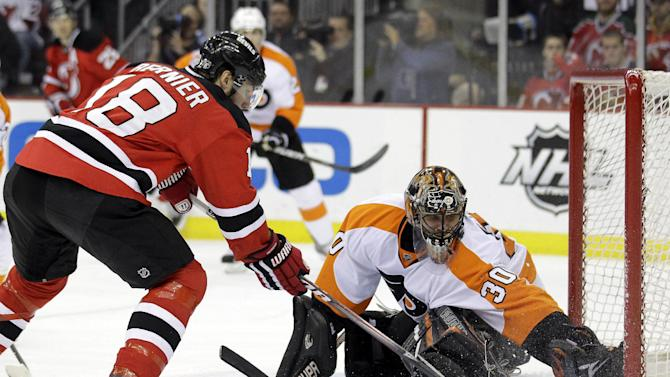 Philadelphia Flyers' Ilya Bryzgalov (30), of Russia, makes a save on a shot by New Jersey Devils' Steve Bernier (18) during the second period of Game 4 of a second-round NHL hockey Stanley Cup playoff series, Sunday, May 6, 2012, in Newark, N.J. (AP Photo/Julio Cortez)