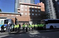 Policemen stand guard in front of the Japanese embassy in Seoul in 2011. Tokyo and Beijing have been locked in a diplomatic fight over a Chinese man who hurled petrol bombs at the Japanese embassy in Seoul, officials said Friday