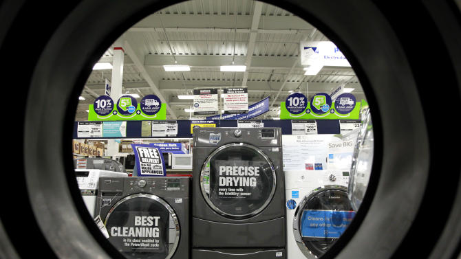 FILE - In this Monday, Sept. 10, 2012 file photo, dryers are seen from the inside of another clothes' dryer, foreground, at a Lowe's store, in Framingham, Mass. The Commerce Department reports on business orders for durable goods in July, on Monday, Aug. 26, 2013 (AP Photo/Steven Senne, File)