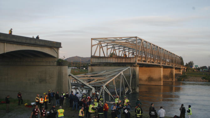 A portion of the Interstate-5 bridge is submerged after it collapsed into the Skagit river dumping vehicles and people into the water in Mount Vernon, Wash., Thursday, May 23, 2013 according to the Washington State Patrol. (AP Photo/Joe Nicholson)