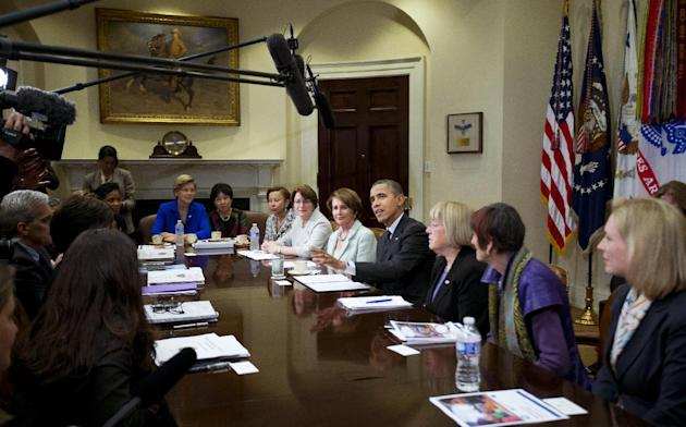 President Barack Obama, center right, joins women members of Congress in a meeting to discuss the administration's economic agenda and minimum wage efforts at the White House in Washington, Wednesday,