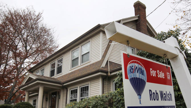 In this Nov. 16, 2011 photo, a for sale sign hangs in front of a home, in Milton, Mass. Existing-home sales improved in October while the number of homes on the market continued to decline, according to the National Association of Realtors(R). (AP Photo/Steven Senne)
