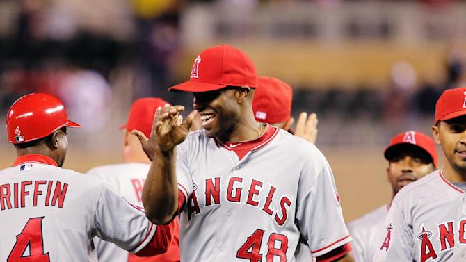 Los Angeles Angels right fielder Torii Hunter (48) celebrates with teammates after defeating the Minnesota Twins 8-3 in a baseball game, Monday, May 7, 2012, in Minneapolis. (AP Photo/Genevieve Ross)