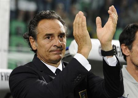 Italy's coach Prandelli greets supporters before their World Cup qualifying soccer match against Bulgaria in Palermo