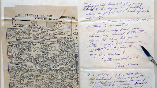 This Sept. 11, 2012, photo shows a letter and newspaper clipping sent to Ernest Hemingway from writer Paul Drus in 1938, a part of the Hemingway collection at the John F. Kennedy Library and Museum in Boston, which is being sent out for restoration. Among letters written to Ernest Hemingway slated for repair are dispatches from public figures including Hollywood stars Ingrid Bergman and Marlene Dietrich, writers F. Scott Fitzgerald and Gertrude Stein, and Hemingway's editor Max Perkins. (AP Photo/Stephan Savoia)