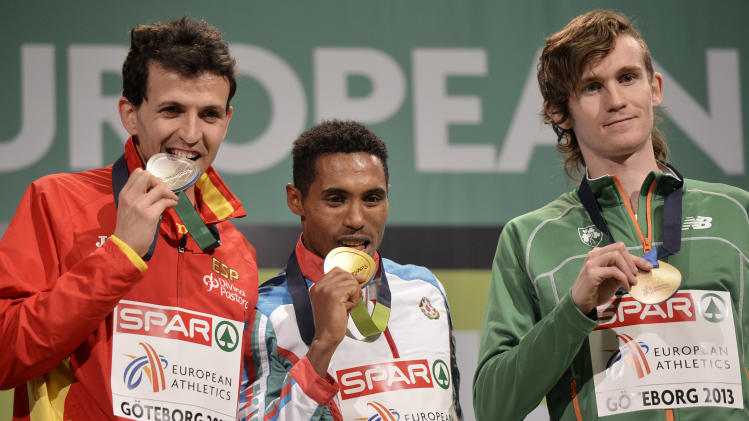 Azerbaijan's gold medal winner Hayle Ibrahimov is flanked by Spain's silver medalist Juan Carlos Higuero, left, and Ireland's bronze medal winner Ciaran O'Lionaird during the medal ceremony for the men's 3000m at the Athletics Indoors European Championships in Gothenburg, Sweden, Saturday, March 2, 2013. (AP Photo/Martin Meissner)