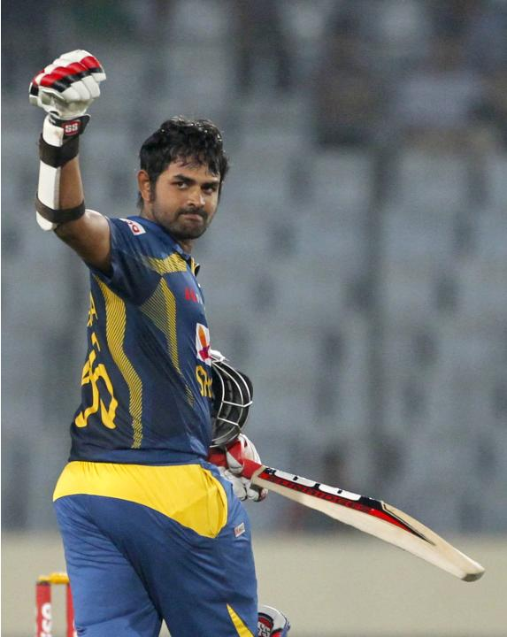 Sri Lanka's Thirimanne celebrates after scoring a century against Pakistan during their 2014 Asia Cup final match in Dhaka.