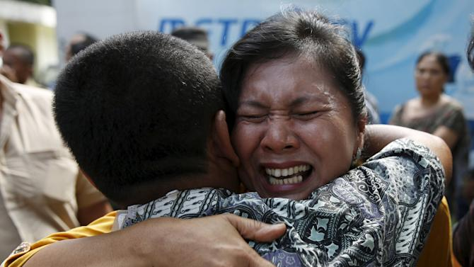 A woman cries after confirming that her brother was among the victims of an Indonesian military C-130 Hercules transport plane that crashed into a residential area, outside the Adam Malik hospital in Medan