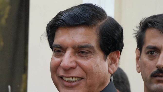 Pakistan's premier-designate Raja Pervaiz Ashraf meets his supporters in Islamabad, Pakistan, on Friday, June 22, 2012. Pakistan's ruling party named a loyalist tainted both by corruption allegations and failure to end the country's energy crisis as its candidate for prime minister, setting up what is likely to be a short and turbulent premiership. (AP Photo/B.K. Bangash)