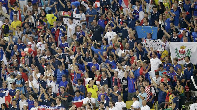France fans celebrate after the 0-0 draw against Ecuador puts France through to the next round during the group E World Cup soccer match between Ecuador and France at the Maracana Stadium in Rio de Janeiro, Brazil, Wednesday, June 25, 2014. (AP Photo/Andrew Medichini)