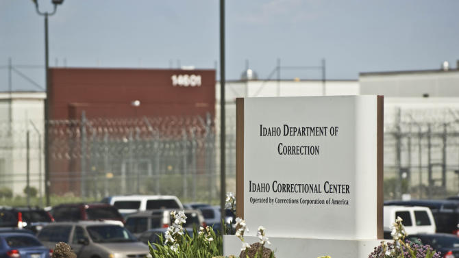 FILE - In this June 15, 2010 file photo, the Idaho Correctional Center is shown south of Boise, Idaho. A gang war that appears to have taken over parts of an Idaho private prison is spilling into the federal courts. A group of inmates at the Idaho Correctional Center is suing Corrections Corporation of America, contending the company is working with a few powerful prison gangs to control the facility and save money on staffing.(AP Photo/Charlie Litchfield, File)
