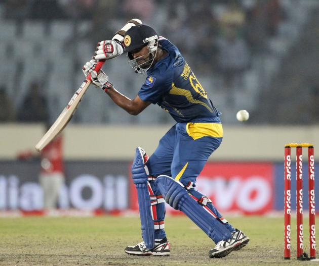 Sri Lanka's Lahiru Thirimanne plays a shot against Pakistan during their 2014 Asia Cup final match in Dhaka