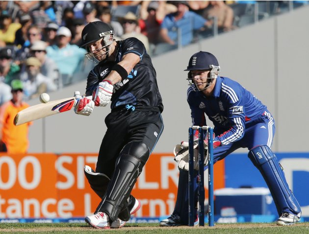 McCullum of New Zealand plays the shot he went out to watched by Buttler of England during the final cricket match of their one day international series at Eden Park, Auckland