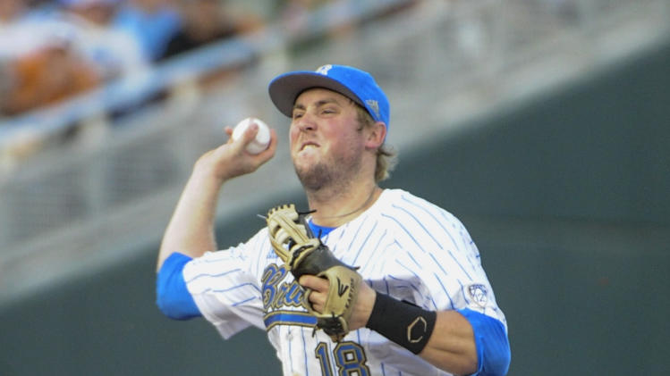 UCLA second baseman Cody Regis (18) throws to first for a double play after forcing out North Carolina's Cody Stubbs (25) in the fourth inning of an NCAA College World Series baseball game in Omaha, Neb., Friday, June 21, 2013. (AP Photo/Francis Gardler)
