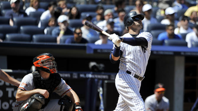 New York Yankees' Nick Swisher hits a two-run home run off of Baltimore Orioles starting pitcher Chris Tillman in the fourth inning of the first baseball game of a doubleheaderon Saturday, July 30, 2011 at Yankee Stadium in New York. Chris Tatum catches for the Orioles. (AP Photo/Kathy Kmonicek)