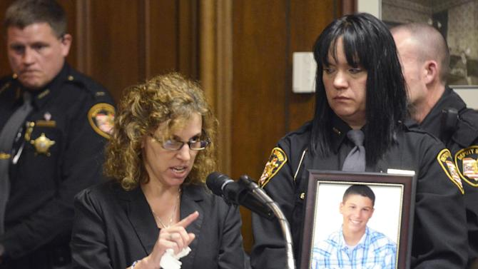 Dina Parmertor, mother of victim Daniel, speaks during the sentencing of T.J. Lane Tuesday, March 19, 2013, in Chardon, Ohio. Lane, was given three lifetime prison sentences without the possibility of parole Tuesday for opening fire last year in a high school cafeteria in a rampage that left three students dead and three others wounded. Lane, 18, had pleaded guilty last month to shooting at students in February 2012 at Chardon High School, east of Cleveland.  (AP Photo/The News-Herald, Duncan Scott, Pool)