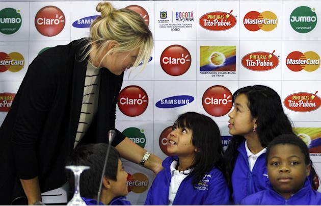 "Russian tennis player Maria Sharapova talks with children of ""Desayunitos"" foundation during a press conference in Bogota, Colombia, Thursday, Dec. 5, 2013. Sharapova and Serbian Ana Ivanovi"