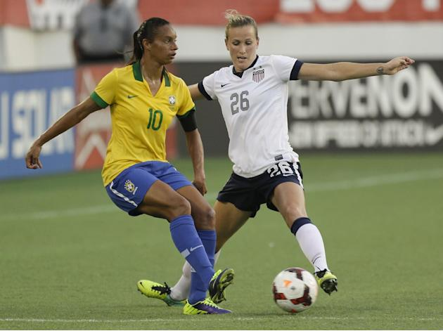U.S. defender Leigh Ann Robinson (26) tries to get control of the ball away from Brazil midfielder Rosana (10) during the second half of an international friendly soccer match in Orlando, Fla., Sunday