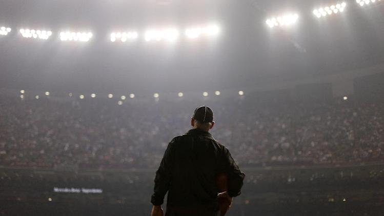 An official looks on during a Superdome power outage in the second half of the NFL Super Bowl XLVII football game between the San Francisco 49ers and the Baltimore Ravens, Sunday, Feb. 3, 2013, in New Orleans. (AP Photo/David Goldman)