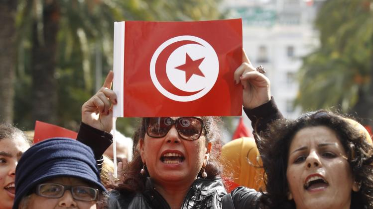 Tunisian woman holds a flag during a march to celebrate International Women's Day in Tunis
