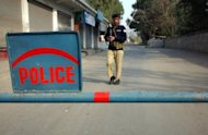 File picture shows a police roadblock in Pakistan. A remote-controlled bomb targeting a passenger van killed at least 14 people and wounded 10 others in northwestern Pakistan on Sunday, police said