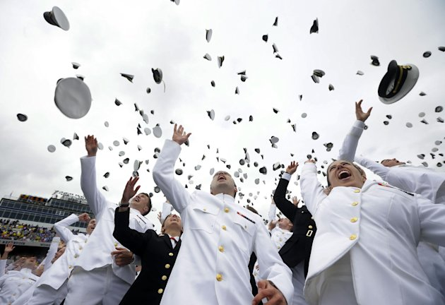 Members of the 2013 graduating class of the United States Naval Academy throw their caps into the air marking the end of their commencement ceremony in Annapolis, Md,. Friday, May 24, 2013, where Pres