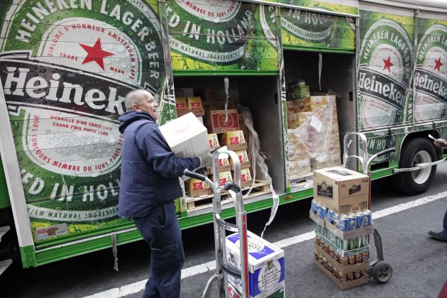 FILE - In this March 28, 2012 file photo, a truck driver delivers Heineken beer and other drinks in New York. Heineken, a Dutch brewing company based in Amsterdam, said Friday, July 20, it is offering $4.1 billion to buy out its partner in the Singapore-based maker of Tiger beer, attempting to neutralize a Thai tycoon's competing bid for influence over the brand as the Dutch brewer expands in emerging markets. (AP Photo/Mark Lennihan, File)