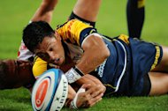 ACT Brumbies flyhalf Christian Lealiifano is tackled during a Super 15 rugby match in Johannesburg on April 27, 2012. Lealiifano had an off night during their game against the Queensland Reds, missing four penalty attempts and failing to convert Jesse Mogg's first try