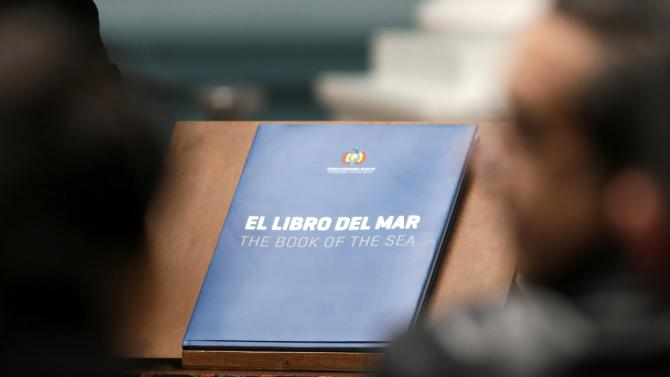 """A copy of """"The Book of the Sea"""" is pictured during an announcement about a nationwide distribution of the book, in La Paz"""