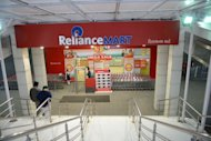 The entrance of the Reliance Mart on Gandhinagar-Sarkhej Highway road in Ahmedabad on January 18, 2013. India&#39;s largest private firm Reliance Industries reported on Friday a surprise 24 percent rise in quarterly net profit as higher refining margins offset slowing output from offshore fields