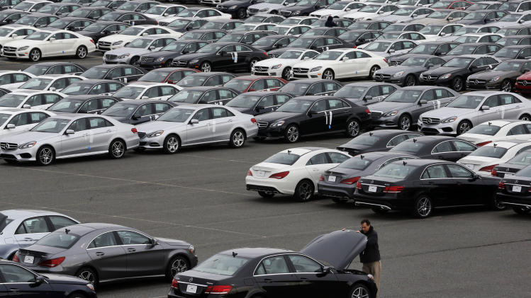 In this March 27, 2014 photo, rows of Mercedes-Benz cars and SUVs await distribution at the company's Vehicle Processing Center in Baltimore. The Commerce Department reports on the U.S. trade deficit for April on Wednesday, June 4, 2014. (AP Photo/Patrick Semansky)
