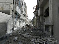 An image released by the Syrian opposition's Shaam News Network shows destruction in Homs on May 22