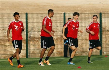 Bayern Munich's players warm up during a training session in Agadir Stadium, Agadir