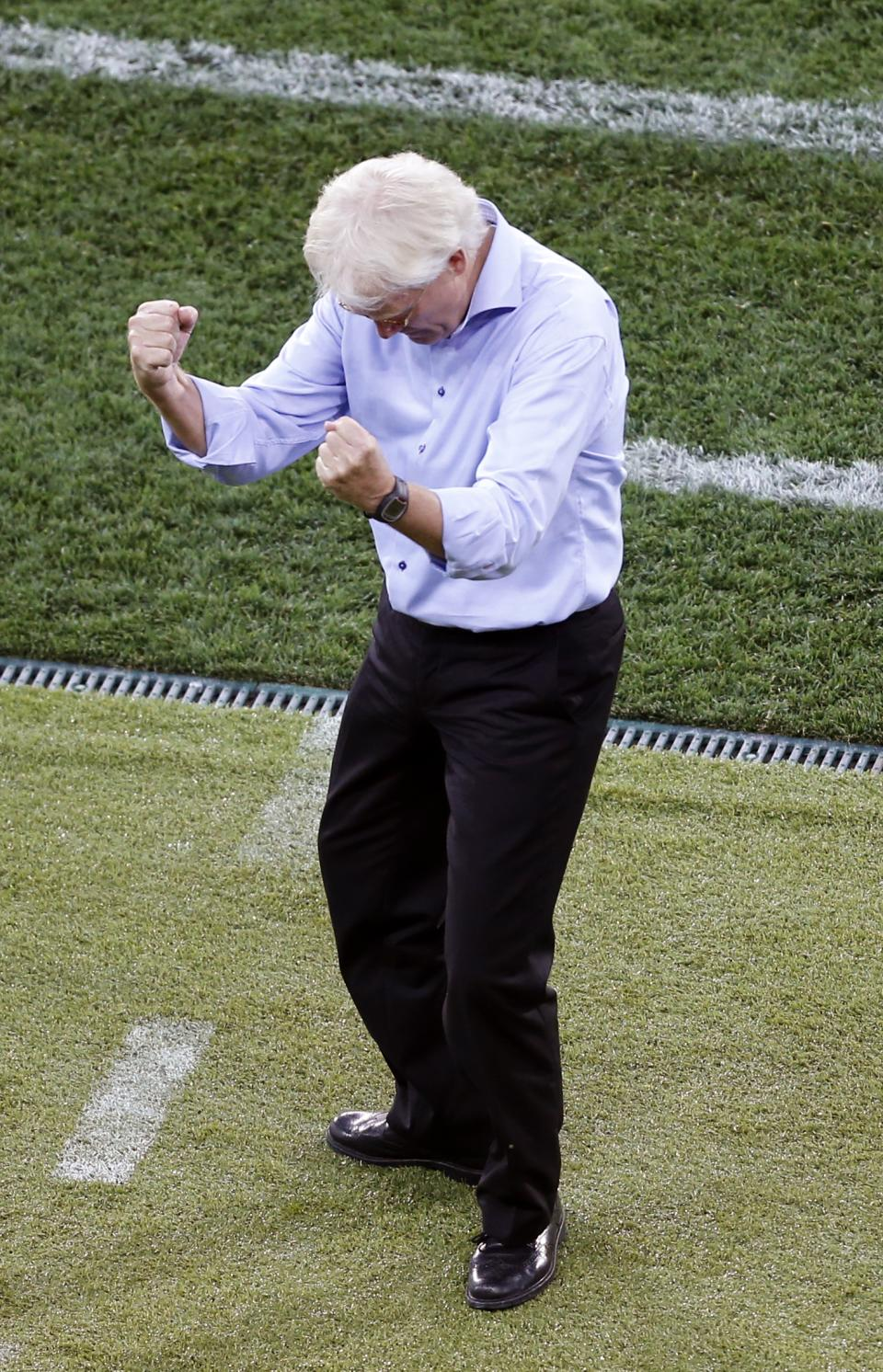 Denmark's head coach Morten Olsen celebrates his side's 1-0 win after the Euro 2012 soccer championship Group B match between the Netherlands and Denmark in Kharkiv , Ukraine, Saturday, June 9, 2012. (AP Photo/Michael Probst)
