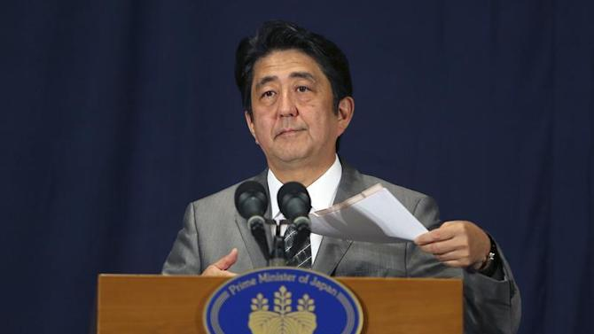 Japan's PM Abe speaks during a news conference in Doha