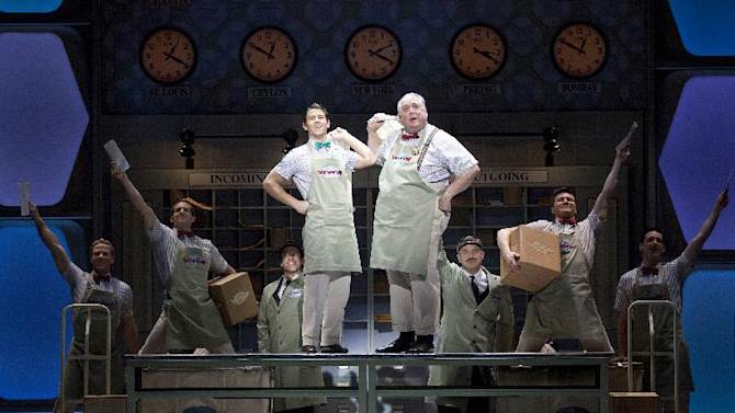 """In this undated publicity image released by The Hartman Group, Nick Jonas and Rob Bartlett perform in a scene from """"How to Succeed in Business Without Really Trying"""" at the Al Hirschfeld Theatre in New York. Jonas tried hard but couldn't keep Broadway's """"How to Succeed in Business Without Really Trying"""" in business. Producers of the musical said Tuesday they they were reluctantly handing it a pink slip after several months of lackluster box office revenue. Its final performance will be May 20. (AP Photo/The Hartman Group, Joan Marcus)"""