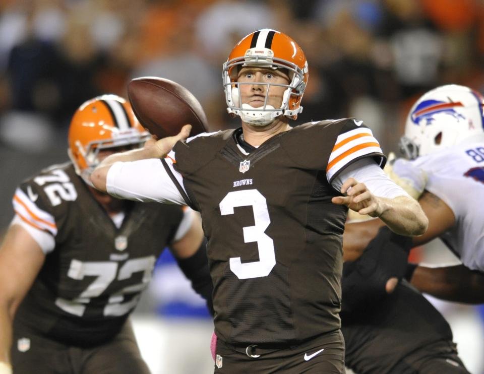 Cleveland Browns quarterback Brandon Weeden passes against the Buffalo Bills in the fourth quarter of an NFL football game Thursday, Oct. 3, 2013, in Cleveland. Weeden took over for starter Brian Hoyer who was injured in the first quarter. (AP Photo/David Richard)