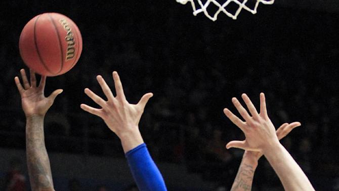 La Salle guard Ramon Galloway (55) shoots against Boise State guard Derrick Marks (2) and Jeff Elorriaga (11) in the first half of a first-round game of the NCAA college basketball tournament, Wednesday, March 20, 2013, in Dayton, Ohio. (AP Photo/Skip Peterson)