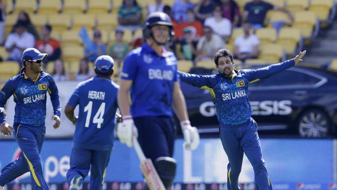 Sri Lanka's Dilshan celebrates taking the wicket of England's Ballance during their Cricket World Cup match in Wellington