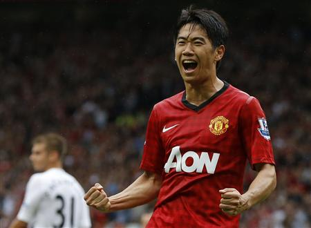 Manchester United's Kagawa celebrates his goal against Fulham during their Premier League match in Manchester
