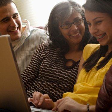 Family-laughing-using-laptop_web