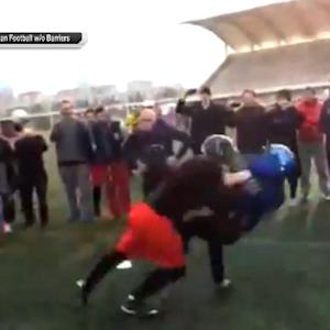 Reporter gets rude welcome to football