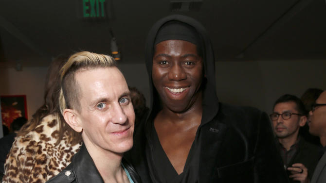 Jeremy Scott and Jay Alexander salute legend of art and fashion Mario Testino with cocktails by Porton at the Peruvian native's exhibition at Prism on Saturday February 23, 2013 in Los Angeles. (Photo by Todd Williamson/Invision for Porton/AP)