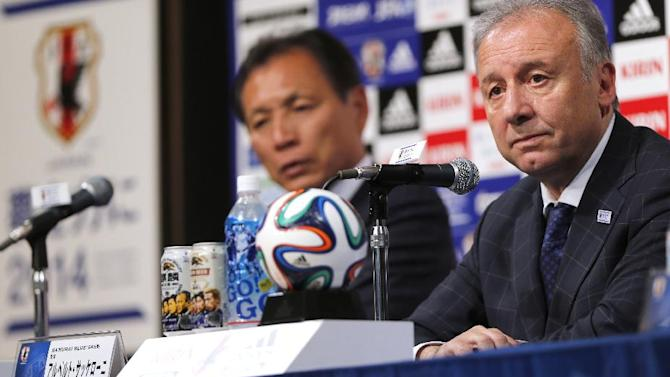 Japan national team soccer coach Alberto Zaccheroni, right, attends a press conference in Tokyo, Monday, May 12, 2014. Japan's Technical Director Hiromi Hara is seen at left.  Zaccheroni announced his 23-man World Cup squad on Monday, picking AC Milan's Keisuke Honda among 12 Europe-based players and adding a surprise with the selection of veteran striker Yoshito Okubo